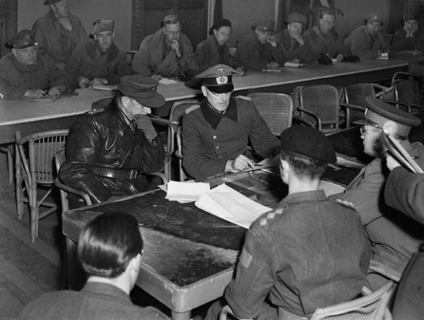 Lieutenant-General Foulkes and General Reichilt negotiating the surrender of German forces in the Netherlands. Date: 5 May 1945 Place: Wageningen, Netherlands Extent: 108 x 133 mm Terms of use Credit: Alexander M. Stirton / Canada. Dept. of National Defence / Library and Archives Canada / PA-137730Restrictions on use: NilCopyright: ExpiredPhotographer: Alexander M. Stirton